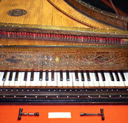 antique harpsichord with tuning forks